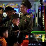 North Koreans soldiers play an arcade game at the Pyongyang Pleasure park Sept. 22, 2013, in Pyongyang, North Korea.