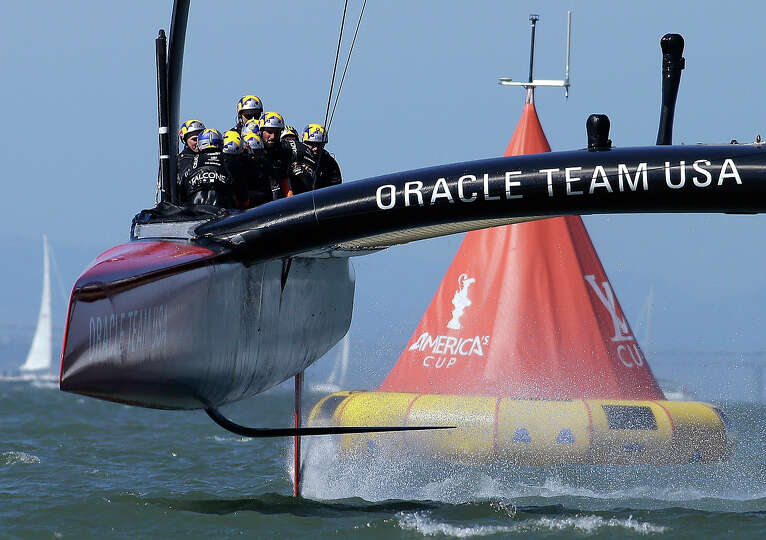 Oracle Team USA crosses the finish line during the 18th race of the America's Cup sailing event agai