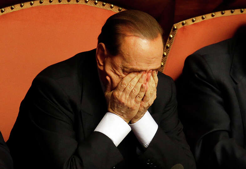 People of Freedom party leader Silvio Berlusconi rubs his eyes after delivering his speech at the Se