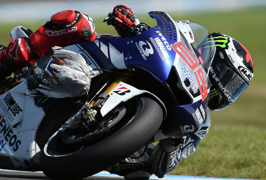Yamaha MotoGP rider Jorge Lorenzo of Spain controls his bike on turn 11 after a bird hit the front of his fairing during the qualifying session of the MotoGP Australian motorcycle Grand Prix in Phillip Island, Australia, Saturday, Oct. 19, 2013. Lorenzo qualified fastest to take pole position for the Australian MotoGP. Photo: Rob Griffith, ASSOCIATED PRESS / AP2013