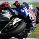 Yamaha MotoGP rider Jorge Lorenzo of Spain controls his bike on turn 11 after a bird hit the front of his fairing during the qualifying session of the MotoGP Australian motorcycle Grand Prix in Phillip Island, Australia, Saturday, Oct. 19, 2013. Lorenzo qualified fastest to take pole position for the Australian MotoGP.