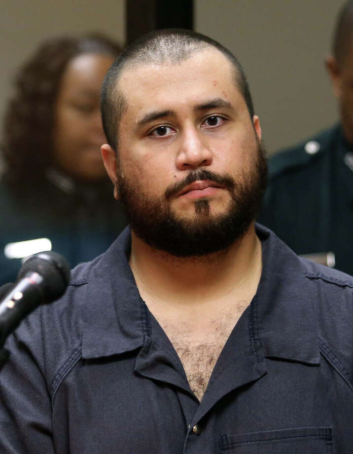 George Zimmerman, acquitted in the high-profile killing of unarmed black teenager Trayvon Martin, listens in court Tuesday, Nov. 19,  2013, in Sanford, Fla., during his hearing on charges including aggravated assault stemming from a fight with his girlfriend. Photo: Joe Burbank, ASSOCIATED PRESS / AP2013