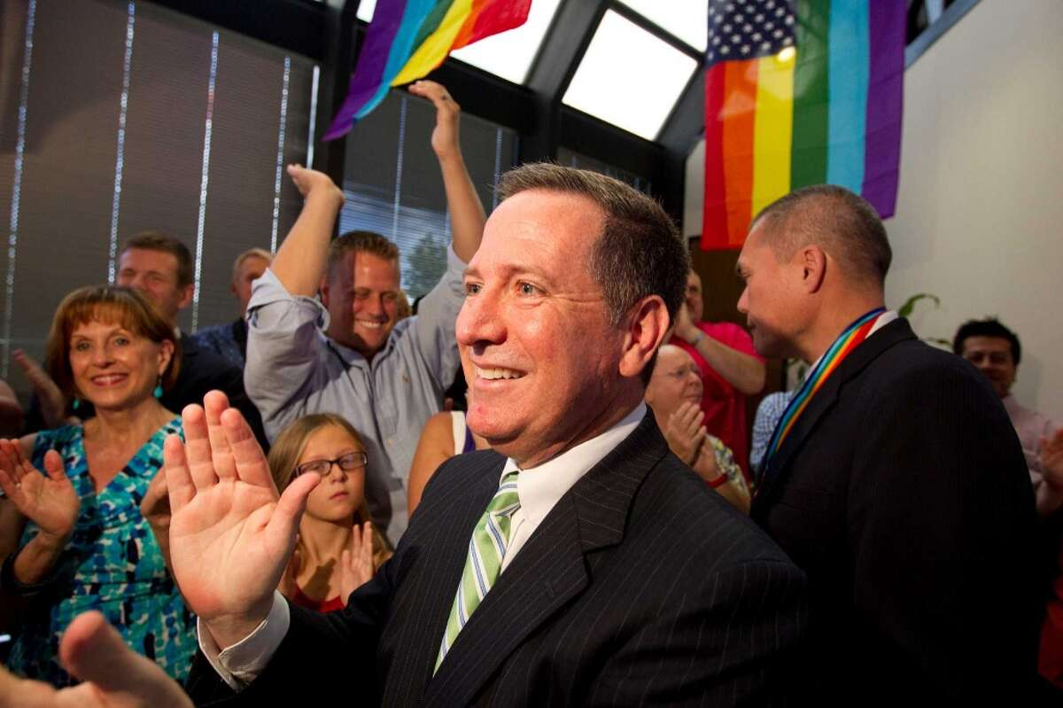 Mitchell Katine, celebrates the Supreme Courts decision to overturn the The Defense of Marriage Act at the law offices of Katine & Nechman L.L.P. Wednesday, June 26, 2013, in Houston. The Supreme Court on Wednesday struck down the Defensive Marriage Act, the provision of a federal law denying federal benefits to married gay couples, and cleared the way for the resumption of same-sex marriage in California. Katine was the attorney involved in the landmark case that resulted in the US Supreme Court decision to overturn all laws banning sodomy with Lawrence v. Texas. ( Johnny Hanson / Houston Chronicle )