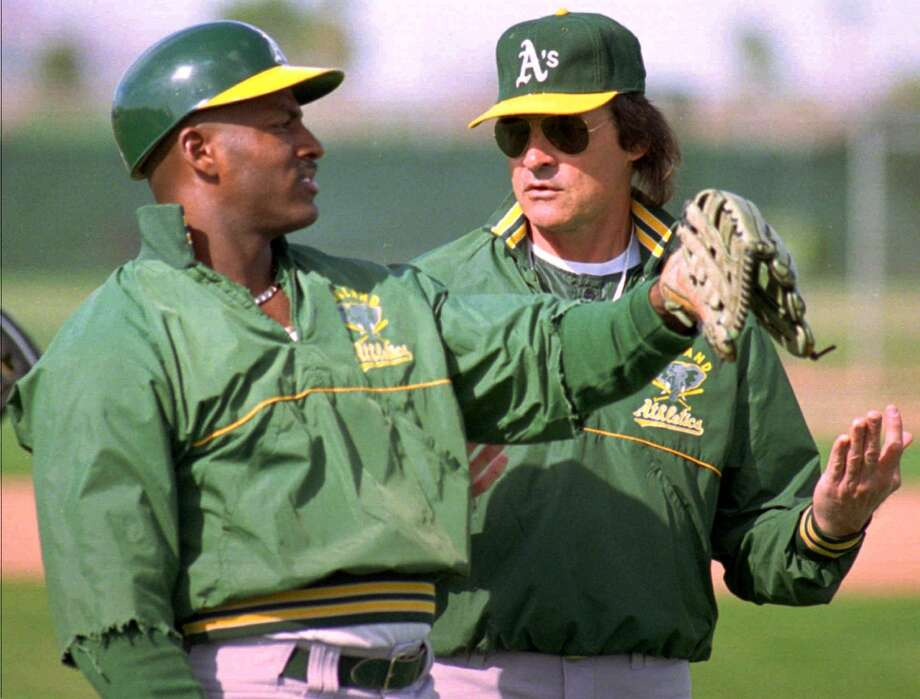 Oakland Athletics manager Tony La Russa, right, talks with Ruben Sierra Sunday Feb. 27, 1994, during spring training in Scottsdale, Ariz. Photo: JEFF ROBBINS, Associated Press