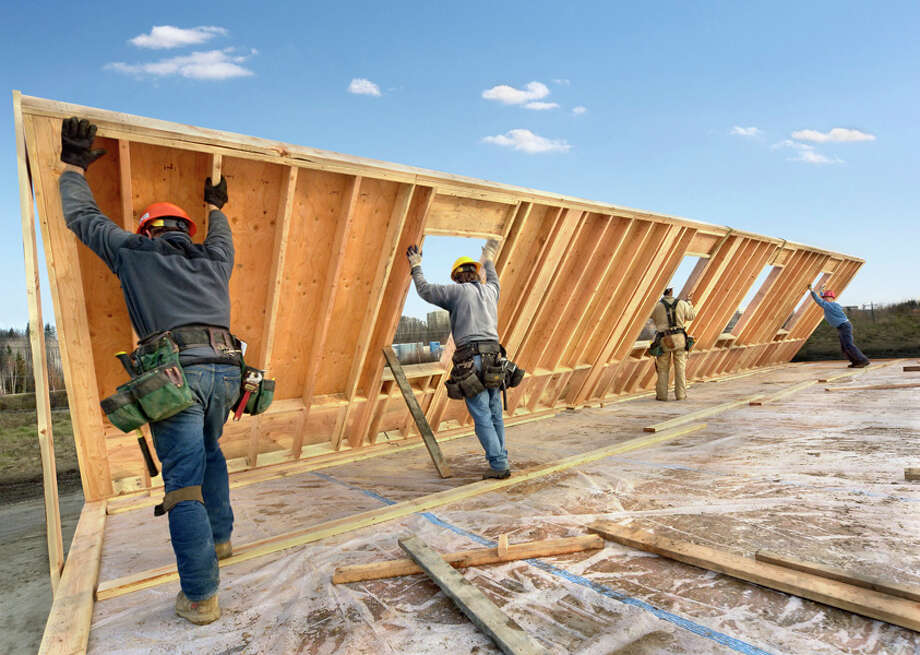 $12.62 - Construction Laborers Source: U.S. Bureau of Labor Statistics. Numbers reflect median hourly wage for workers in Houston-Sugar Land-Baytown metro area, as of May 2012. Photo: Lester Lefkowitz, Getty Images / (c) Lester Lefkowitz