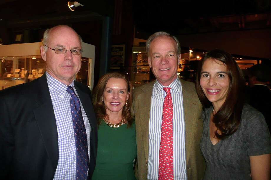 Among the guests at Antiquarius, the Greenwich Historical Society's Winter Antiques Show, were,  from left, Peter McGowan, Greenwich Historical Society Trustee Lynne Wheat, Tom Foley and his wife, Leslie Foley. Photo: Anne W. Semmes / Greenwich Citizen