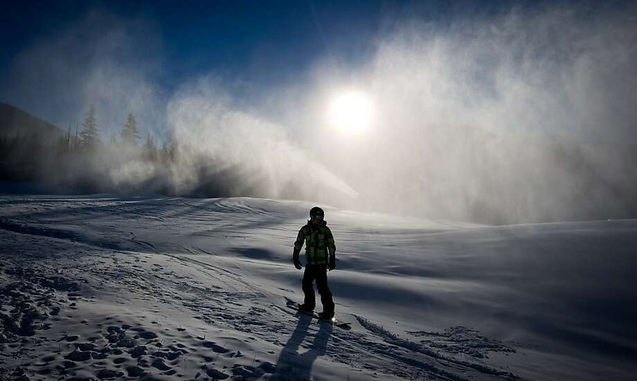 Let if fake-snow, let it fake-snow, let it fake-snow ...A snowboarder slides down Blackcomb Mountain as ice crystals from a snow-making machine hang in the air in   Whistler, B.C. Photo: Darryl Dyck, Associated Press