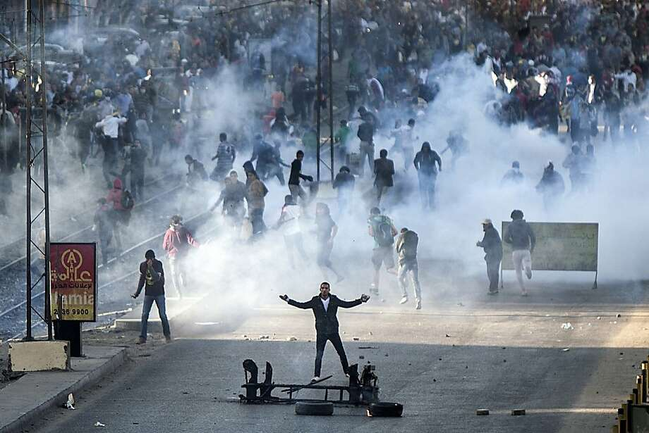 Islamist protest squashed:Supporters of the Muslim Brotherhood and ousted president Mohammed Morsi clash with Egyptian riot police during a 