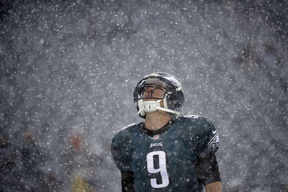 My spotless interception record may be in jeopardy:Eagles' quarterback Nick Foles looks up at the falling snow before the game against the Detroit Lions in Philadelphia. At least 4 inches of snow accumulated on the field during the game. Photo: Matt Rourke, Associated Press