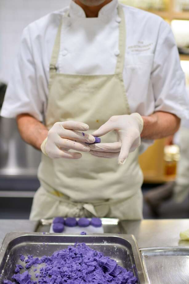 Forming purple potato dumplings to be used in the first course. Photo: Bonjwing Lee Photography