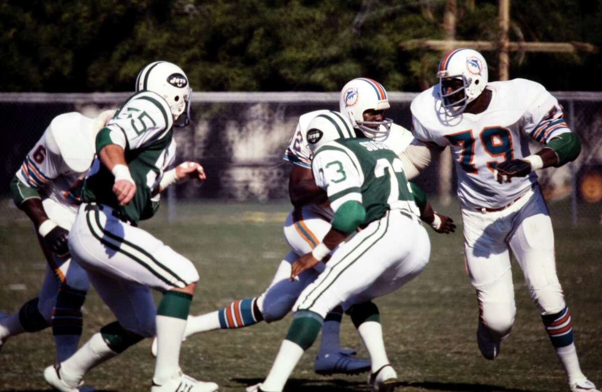 Miami Dolphins left tackle Wayne Moore (No. 79) makes room for a running back during a game against the New York Jets. The former Charlton-Pollard and Lamar star played for the Dolphins for nearly a decade, including winning two Super Bowls. Moore passed away in 1989. -- Courtesy of the Miami Dolphins