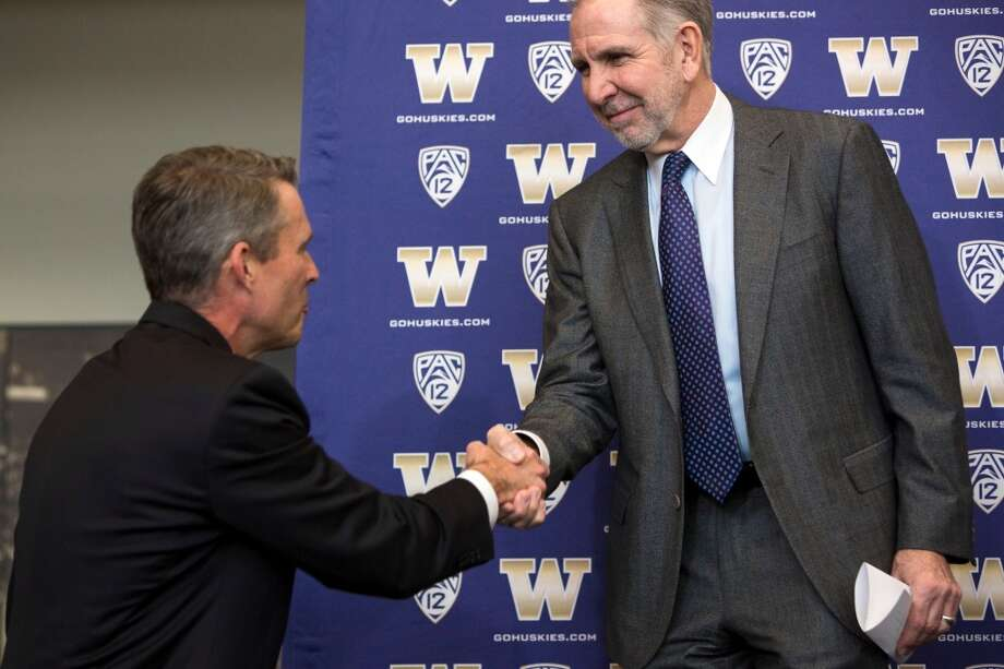 UW president Michael Young, right, greets Chris Petersen, left, newly-named University of Washington football head coach, at a press conference Monday, Dec. 9, 2013, at Husky Stadium in Seattle. Petersen replaces former head coach Steve Sarkisian, who left for USC. (Jordan Stead, seattlepi.com) Photo: JORDAN STEAD, SEATTLEPI.COM