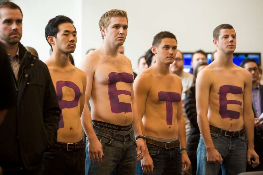 "Fans spell ""Pete"" on their chests to support Chris Petersen, newly-named University of Washington football head coach, at a press conference Monday, Dec. 9, 2013, at Husky Stadium in Seattle. Petersen replaces former head coach Steve Sarkisian, who left for USC. (Jordan Stead, seattlepi.com) Photo: JORDAN STEAD, SEATTLEPI.COM"