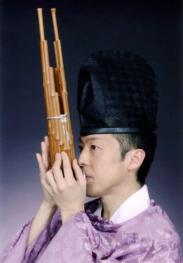 Ko Ishikawa plays the sho, a Japanese mouth organ. Photo: Courtesy Stanford Live