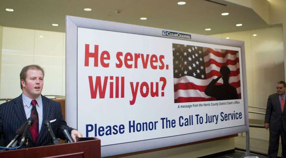 Harris County District Clerk Chris Daniel unveiled a new billboard campaign donated by Clear Channel Outdoors calling Harris County residents to honor their call to jury duty, at the Harris County Jury Plaza Wednesday, Dec. 4, 2013, in Houston. Daniel said the juror appearance rate has increased 4 percent in the last two years and 9 percent in the last decade. ( Johnny Hanson / Houston Chronicle ) Photo: Johnny Hanson, Staff / Houston Chronicle