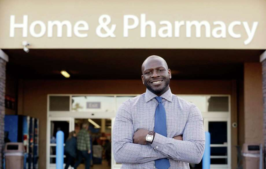 "This photo taken Nov. 21, 2013 shows James Lott outside the Wal-Mart store where he works as a pharmacist in Bonney Lake, Wash. Lott, who lives in Renton, Wash., a suburb of Seattle, adds significantly to his six-figure job salary by day-trading stocks. It's not just the wealthiest 1 percent: Fully 20 percent of U.S. adults become rich for parts of their lives, wielding outsized influence on America's economy and politics. And this little-known group may pose the biggest barrier to reducing the nation's income inequality. While the growing numbers of the U.S. poor have been well documented, survey data provided exclusively to The Associated Press detail the flip side of the record income gap: the rise of the ""new rich."" Photo: Elaine Thompson, AP / AP"