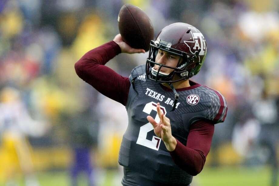 Johnny Manziel   School: Texas A&M  Position: Quarterback Photo: Cody Duty, Houston Chronicle
