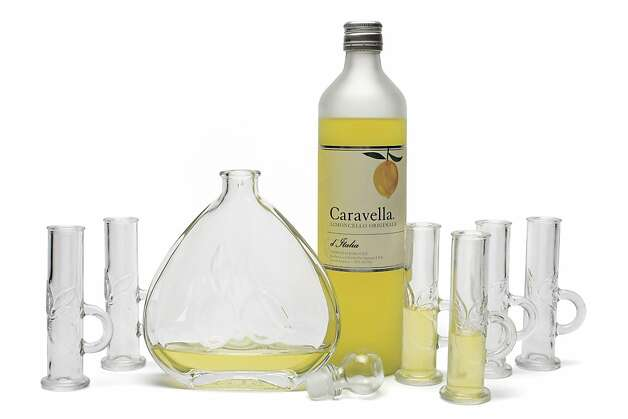 A dishwasher and freezer safe limoncello set with a teardrop-shaped carafe and six tall, narrow glasses hints of warm summer evenings ahead, $59, www.napastyle.com. Then again, Paolo Sperone's Caravella limoncello might be a welcome break from mulled, spiced or sweet holiday drinks, $19.99, www.bevmo.com. Photo: Russell Yip, The Chronicle