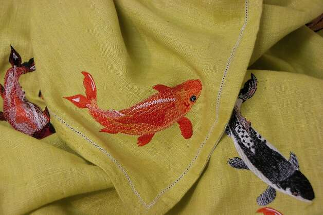 STOCKING STUFFERS: This hand-embroidered 60-inch-square tablecloth renders a koi pond in linen, $524, www.mytallulah.com. Photo: Unknown