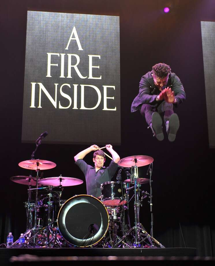 "Davey Havok (jumping) and Adam Carson of AFI perform at Live 105 Radio ""Not So Silent Night"" on Day 1 at ORACLE Arena on December 6, 2013 in Oakland, California. (Photo by Steve Jennings/Getty Images for CBS Radio, Inc.) Photo: Steve Jennings"