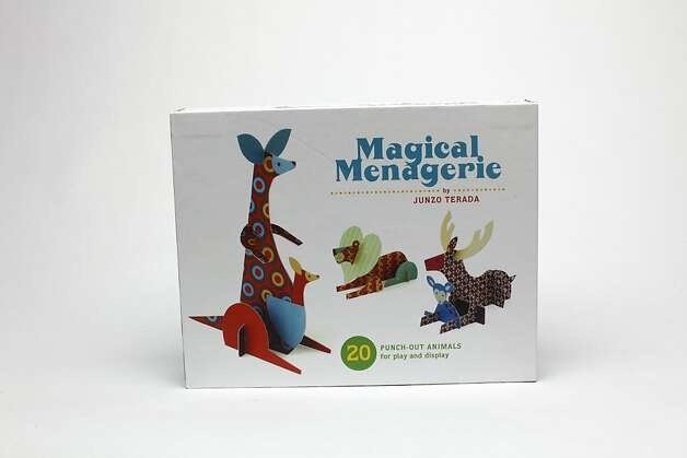 """KIDS' STUFF: Junzo Terada, an artist who lives in Osaka, San Francisco's sister city since 1957, created 20 punch-out animals for """"The Magical Menagerie,"""" $24.95, www.chroniclebooks.com. Photo: Russell Yip, The Chronicle"""