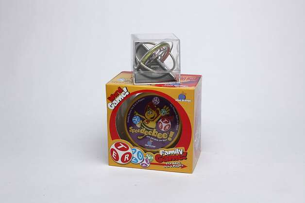 KIDS' STUFF: If you were driving the family space capsule, a TedCo gyroscope might come in handy for navigation, $8.99. But since you're driving the family car, keep the peace with the Family Word Game! Speedeebee, $14.99, Cole Hardware, 956 Cole St., (415) 753-2653. Photo: Russell Yip, The Chronicle