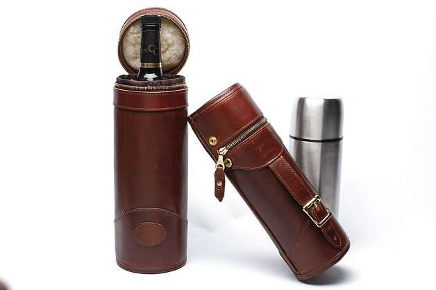 WINTER ACCESSORIES: Protect liquids from winter weather with an assist from J.W. Hulme, a Minnesota company established in 1905. Its all-leather, fleece-lined cases with brass zippers come in two models: with an adjustable handle for easy pouring from a thermos, $340, and a simpler carrying case, $250, for wines or spirits, www.jwhulmeco.com. Photo: Russell Yip, The Chronicle