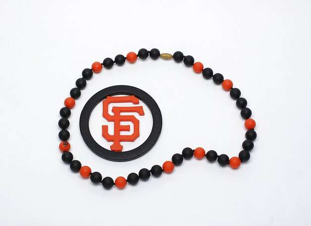 HIS & HERS: For very young fans, a MLB S.F. Giants teether, $18.50 and necklace, $34.50, which mothers and others have been known to borrow on game days, www.chewbeads.com. Photo: Russell Yip, The Chronicle