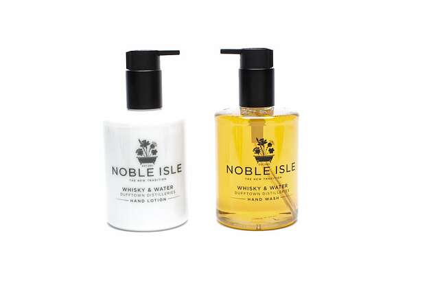 MEN'S: There's skin-calming extract of Scottish malted barley in the Whiskey & Water Duffton Distilleries hand wash, $28, and hand lotion, $32, by Noble Isle, www.barneys.com, giving the products a scent that evokes an oak-aged single malt. Photo: Russell Yip, The Chronicle