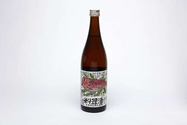 """SAKE: Konnichiha premium cooking sake from Fukushima Prefecture is aged two years and pours like liquid umami to enhance everything from steamed clams to ramen. The kanji on the label says: """"The sea bream (Tai) can't wait to be cooked in the sake because it is so good!"""" $24, www.truesake.com Photo: Russell Yip, The Chronicle"""