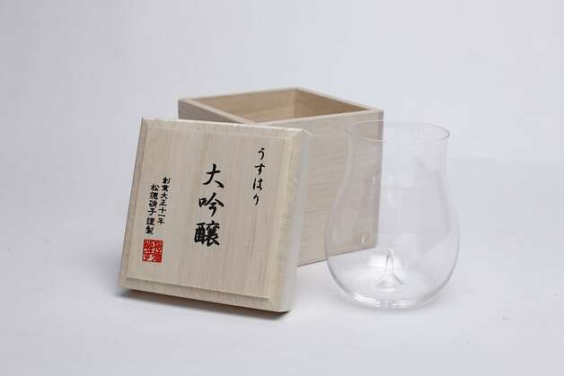 SAKE: The Ushuhari sake glass is made by Japan's Shotoku Glass Company. Inspired by the design of the company's light bulbs, the hand-blown glass, $56, comes in a traditional gift box made from kiri, www.umamimart.com, and comes in its own wooden box. Photo: Russell Yip, The Chronicle