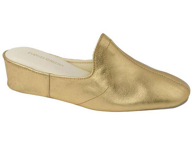 HIS & HERS: A pair of Daniel Green's tootsie-comforting, golden glam slippers could work wonders as faux shapewear inside a holiday stocking hanging from a mantel or a doorknob. $60, www.danielgreen.com. Photo: Daniel Green