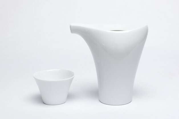 SAKE: Kotobuki makes the white porcelain tokkuri and cup for serving cold sake; the tokkuri is $22, each cup is $5, www.truesake.com. Photo: Russell Yip, The Chronicle