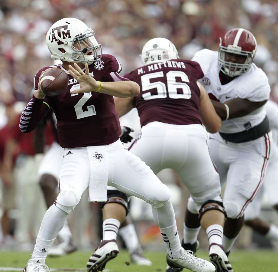 "Alabama 49, Texas A&M 42 Sept. 14, 2013  The much-hyped ""game of the year"" brought out the best in the reigning Heisman winner as Manziel passed for 464 yards and five touchdowns. The QB also rushed for 98 yards in the early-season thriller. Photo: Karen Warren, Houston Chronicle"