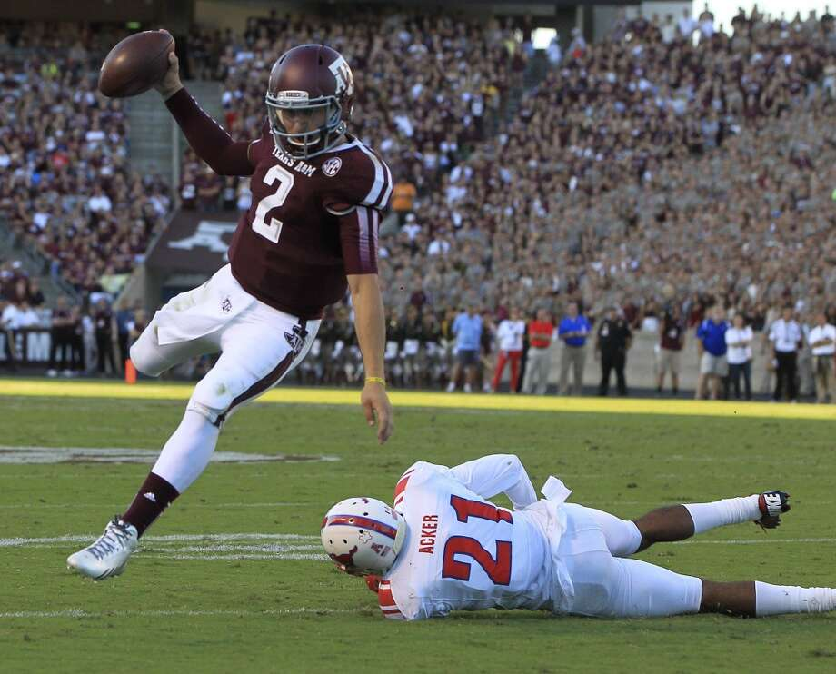 Texas A&M 42, SMU 13 Sept. 21, 2013Manziel used his legs in a romp over the Ponies as he rushed for 102 yards and two scores. He also passed for 244 yards and a touchdown. Photo: Karen Warren, Houston Chronicle