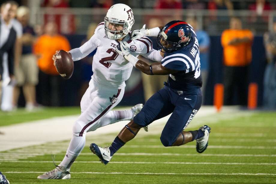 Texas A&M 41, Ole Miss 38 Oct. 12, 2013  In a barn-burner with the Rebels, Manziel passed for 346 yards and rushed for a season-high 124 yards and two touchdowns. Photo: Michael Chang, Getty Images