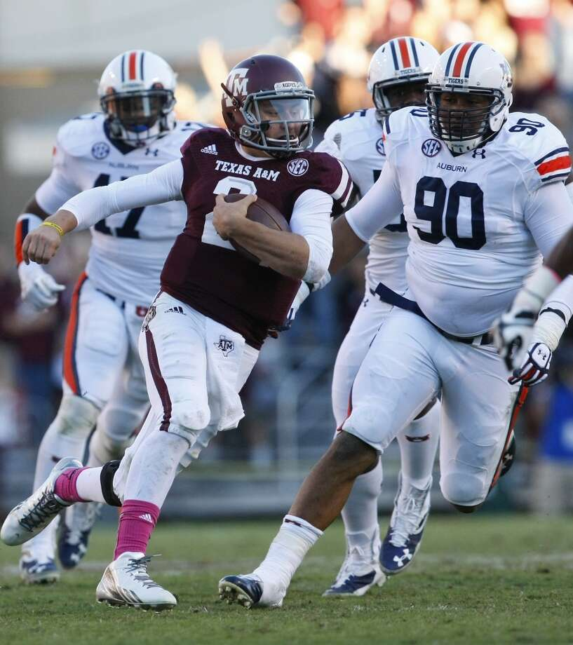 Auburn 45, Texas A&M 41 Oct. 19, 2013Manziel passed for 454 yards and four TDs and rushed another score in the narrow loss to the eventual conference champs. Photo: Cody Duty, Houston Chronicle