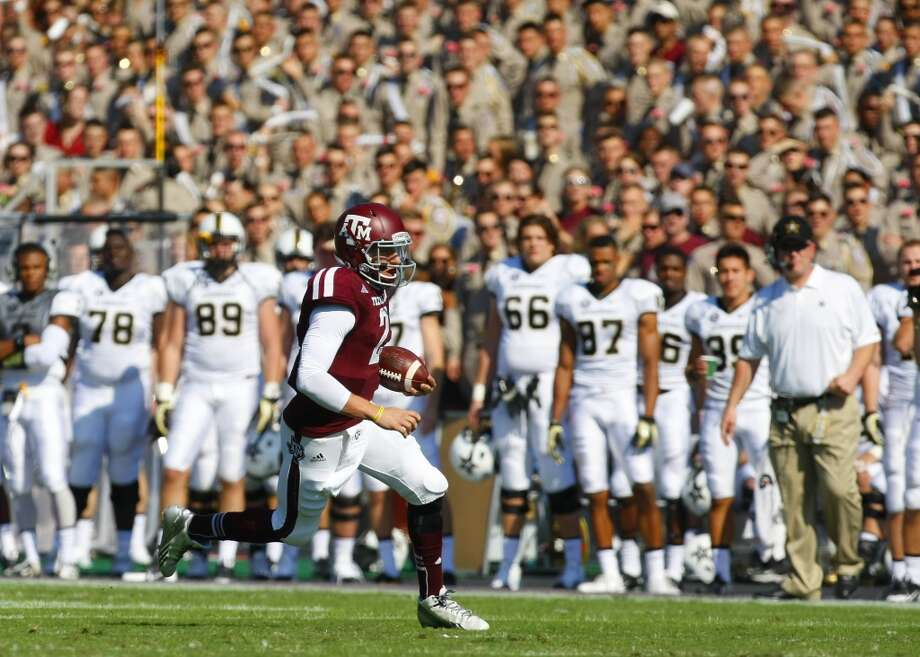 Texas A&M 56, Vanderbilt 24 Oct. 26, 2013  Nursing an injured right shoulder, Manziel threw for 305 yards and four touchdowns in less than three quarters of action. Photo: Cody Duty, Houston Chronicle