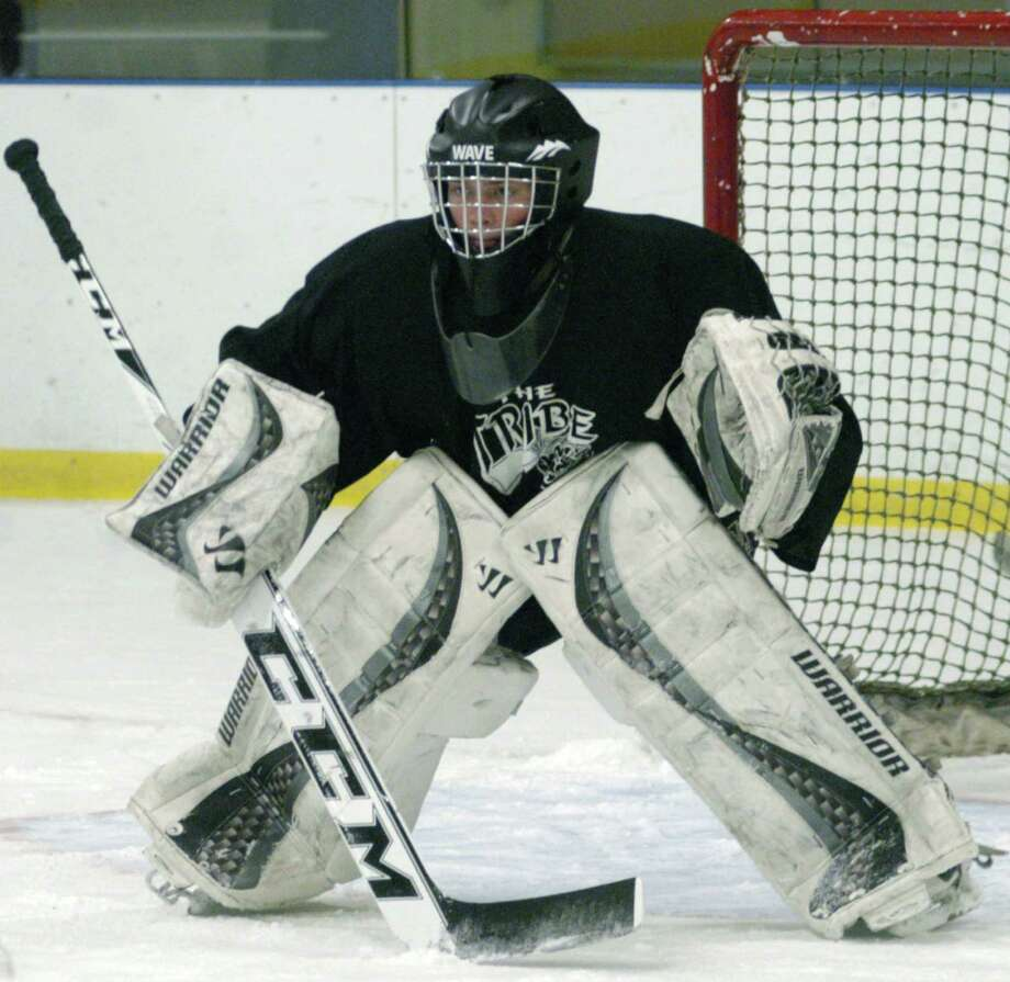 Green Wave goaltender Nick Capriglione is expected to anchor a strong defense this season for New Milford High School's ice hockey team. Dec. 8, 2013 Photo: Norm Cummings / The News-Times