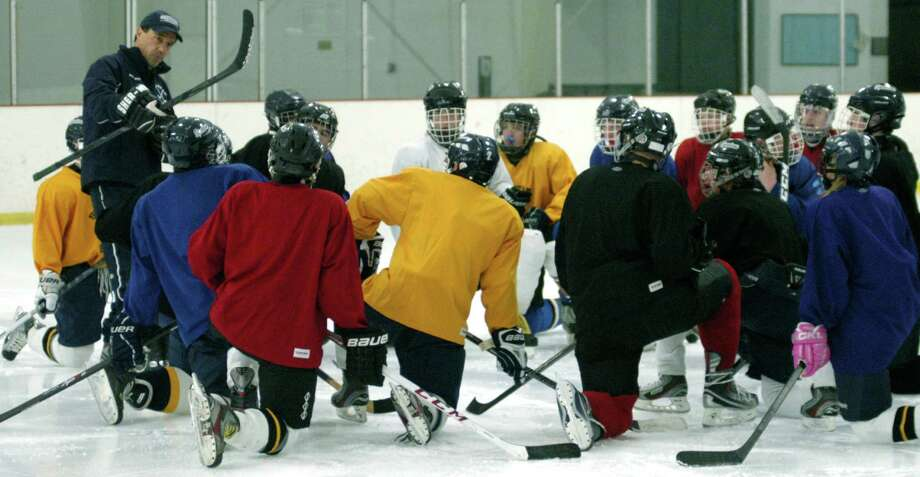 Spartan coach Mike Gorra imparts hockey wisdom to his Shepaug Valley High School co-op ice hockey team during a pre-season practice at The Gunnery rink in Washington. Dec. 6, 2013 Photo: Norm Cummings / The News-Times