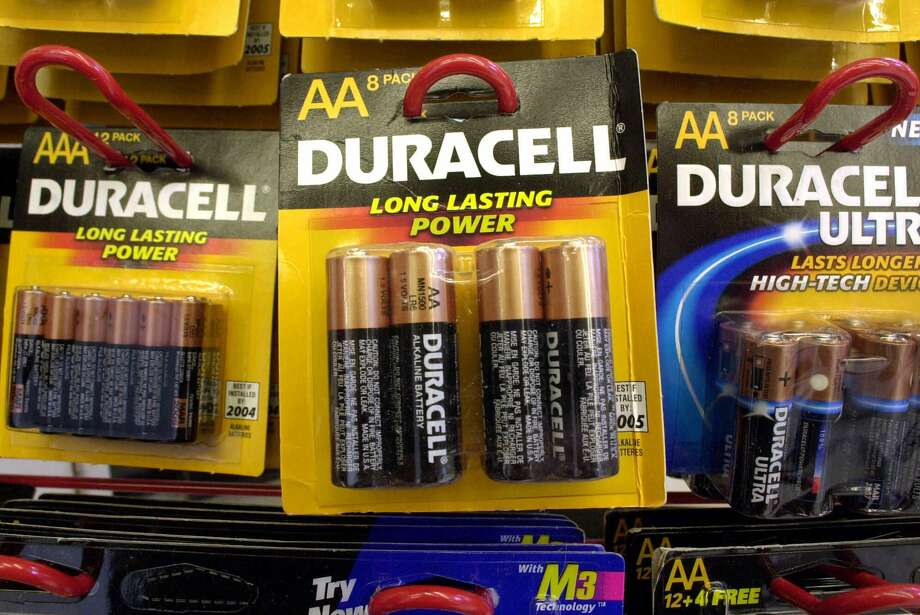 Duracell batteries hang from hooks on display at an office supply store in Boston, Wednesday, March 28, 2001. Photo: STEVEN SENNE, Associated Press / AP2001