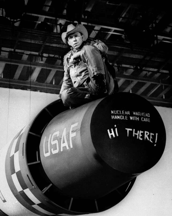 "Actor Slim Pickens sits atop a nuclear weapon prop during production of the movie ""Dr. Strangelove or: How I Learned to Stop Worrying and Love the Bomb"" directed by Stanley Kubrick. Photo: Anonymous, Associated Press / AP"