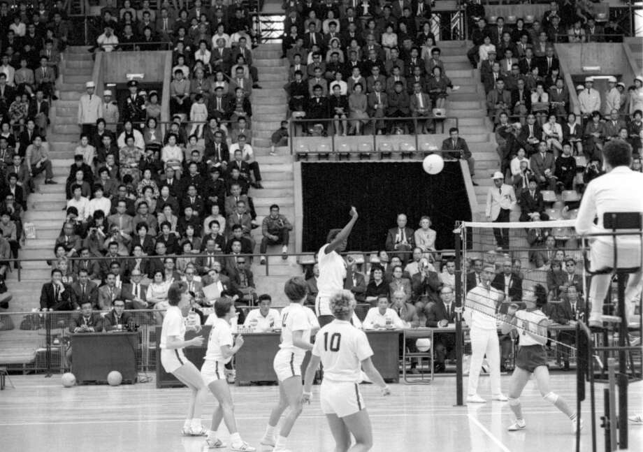 Women's volleyball teams from Japan and the United States compete during the 1964 Summer Olympics in Tokyo on Oct. 11, 1964. The sport debuted at the 1964 games. Photo: Anonymous, Associated Press / AP1964