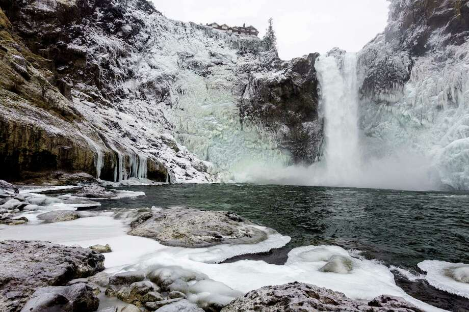 "The cold wave in Western Washington reduced Snoqualmie Falls -- made internationally famous in the TV series ""Twin Peaks"" -- to some world-class icicles Monday, Dec. 9, 2013, in Snoqualmie. The cold temperatures are expected to moderate through the week. Officials at Puget Sound Energy say icy conditions such as these occur about once a year. The conditions have not stopped or hurt power production of the hydroelectric plant at the falls. Water has continued to flow.  Photo: JORDAN STEAD, SEATTLEPI.COM / SEATTLEPI.COM"