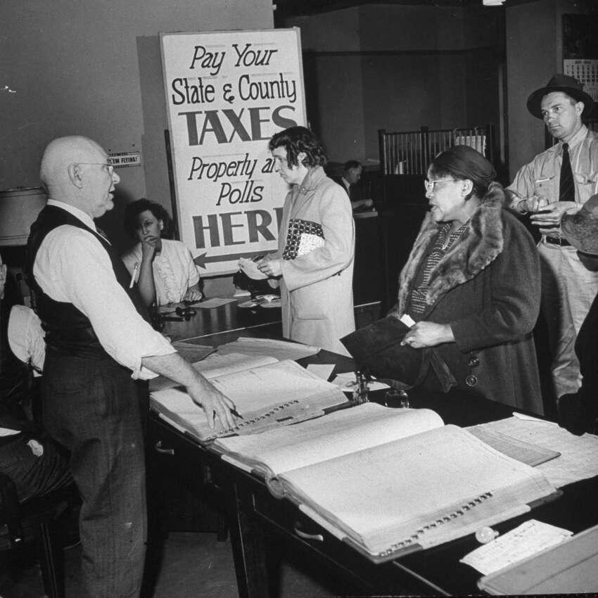 People paying poll taxes, circa 1944.