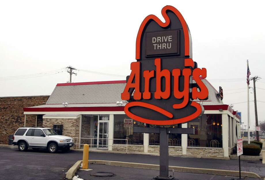 An SUV sits at the pick-up window of an Arby's restaurant Dec. 13, 2002, in Des Plaines, Ill. Photo: Tim Boyle, Getty Images / 2002 Getty Images