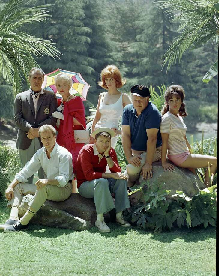 "The cast of ""Gilligan's Island"" is seen in 1964. Back row, from left: Jim Backus as Thurston Howell III, Natalie Schafer as Mrs. Howell, Tina Louise as Ginger Grant, Alan Hale Jr. as the Skipper, and Dawn Wells as Mary Ann Summers. Front row, from left: Russell Johnson as the Professor and Bob Denver as Gilligan. Photo: CBS Photo Archive, Getty Images / 2005 CBS WORLDWIDE INC."