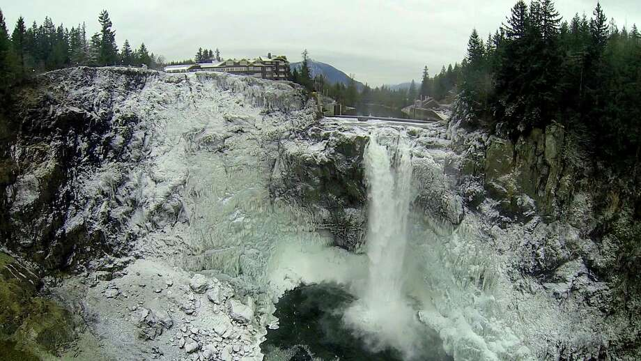 The cold wave in Western Washington reduced Snoqualmie Falls to some world-class icicles Monday, Dec. 9, 2013, in Snoqualmie. The cold temperatures are expected to moderate through the week. Officials at Puget Sound Energy say icy conditions such as these occur about once a year. The conditions have not stopped or hurt power production of the hydroelectric plant at the falls. Water has continued to flow. Photo: CAREY ROSE, PUGET SOUND ENERGY, SPECIAL TO S / PUGET SOUND ENERGY, SPECIAL TO SEATTLEPI.COM
