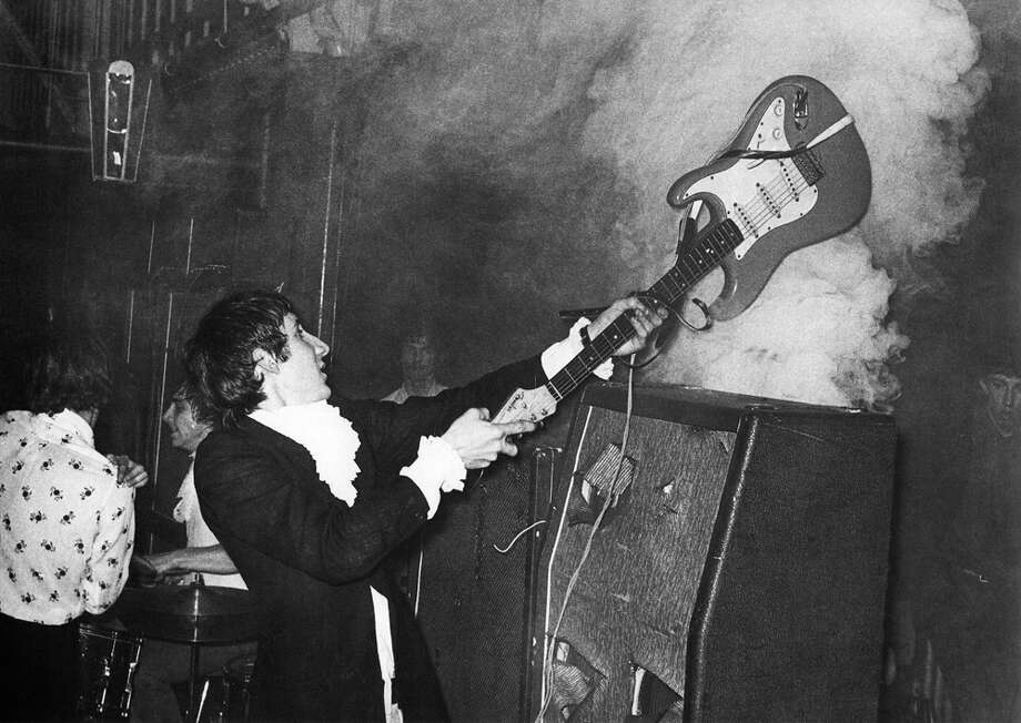 The Who's Pete Townshend smashes his guitar against an amplifier during another show on March 13, 1967. Photo: Chris Morphet, Getty Images / Redferns