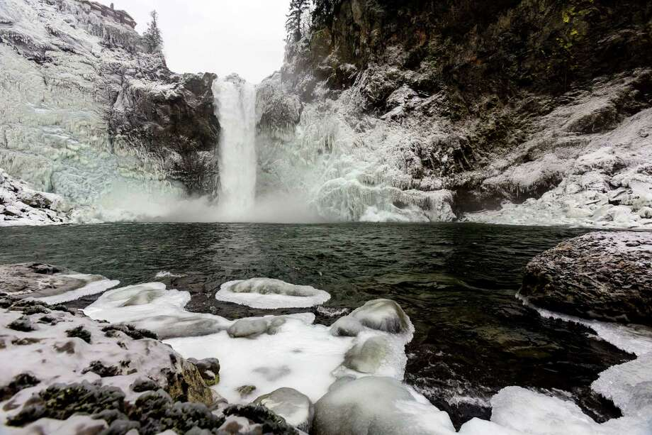 The cold wave in Western Washington reduced Snoqualmie Falls to some world-class icicles Monday, Dec. 9, 2013, in Snoqualmie. The cold temperatures are expected to moderate through the week. Officials at Puget Sound Energy say icy conditions such as these occur about once a year. The conditions have not stopped or hurt power production of the hydroelectric plant at the falls. Water has continued to flow. Photo: JORDAN STEAD, SEATTLEPI.COM / SEATTLEPI.COM